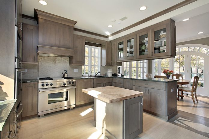 Kitchen in remodeled home with wood cabinetry and island